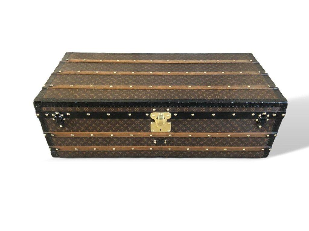 Lot 165 - An unusually large Louis Vuitton cabin trunk covered in monogram canvas, original interior, locks, handles, latches & pins all stamped Louis Vuitton.  120cms wide x 40cms tall x 59cms deep