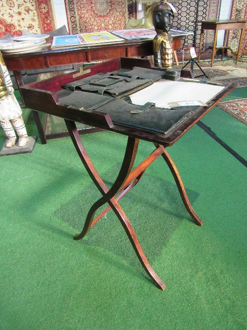 Lot 110 - Late Victorian mahogany folding Campaign desk or carriage desk comes with Moroccan leather fittings
