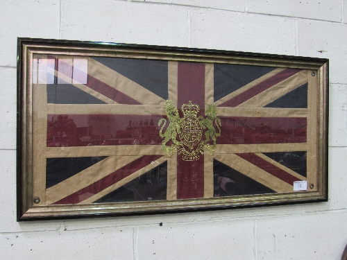 Lot 16 - Framed Union Jack comes with Royal Coat of Arms, 59cms x 119cms. Price guide £20-30.