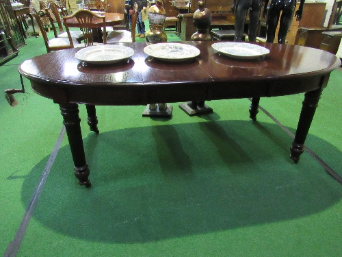 Lot 32 - Mahogany D-end wind-out dining table on turned reeded legs & casters comes with 2 leaves & handle, 212cms x 75cms.