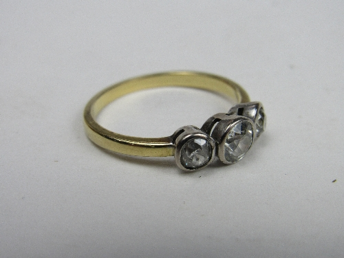 Lot 419 - 18ct gold & platinum ring with large central diamond flanked by 2 smaller diamonds, weight 4.2gms, size T