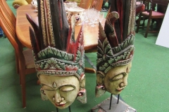 Lot 100 - 2 carved wood tribal faces on stands