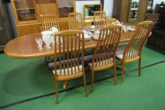 Lot 50 - Teak extending dining table by Preben Schou IS - Denmark, 260cms (extended) x 100cms x 74cms & 6 high back chairs