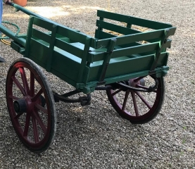 Lot 22 (1) - MINIATURE COSTER CART built circa 1910 to suit 9 to 10 hh pony; a sweet little cart with slatted sides and a drop-down tailboard all painted dark green and in good condition. Supported on English pattern wheels painted red with semi- elliptic springs and rubber tyres. With metal fitting, steps and fixed shafts