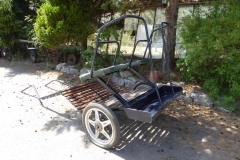 Lot 14 (1) - EXERCISE/BREAKING CART to suit 14.2 hh plus; fitted with two single seats with planked foot board, and a back step with high rails. On pneumatic wheels with blue metalwork lined in red, adjustable shafts and vinyl seating