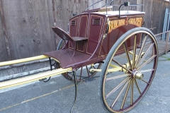 Lot 21 (1) - BUTCHER'S CART to suit 14.2 to 15.2 hh; built by Atkinson & Davidson of Carlisle, in show condition, painted brown with yellow lining and sign written 'Butcher & Grazier' on the sides. On a yellow undercarriage with brown lining, 14-spoke Warner wheels with brass hub caps and transverse and semi-elliptic springs. There are air vents immediately under the driver's seat, and above the rear door, on which is painted a bull's head and sign written 'Finest Beef, Quality Butcher, Est. 1890'. Fitted with lamp brackets, steps and grab handles