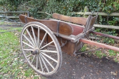 Lot 4 (1) - SMALL FLOAT in natural varnished wood with drop-down tail board, side boards and dash board with rein rail. On 16-spoke wheels (not original) and semi-elliptic springs; one shaft has been repaired