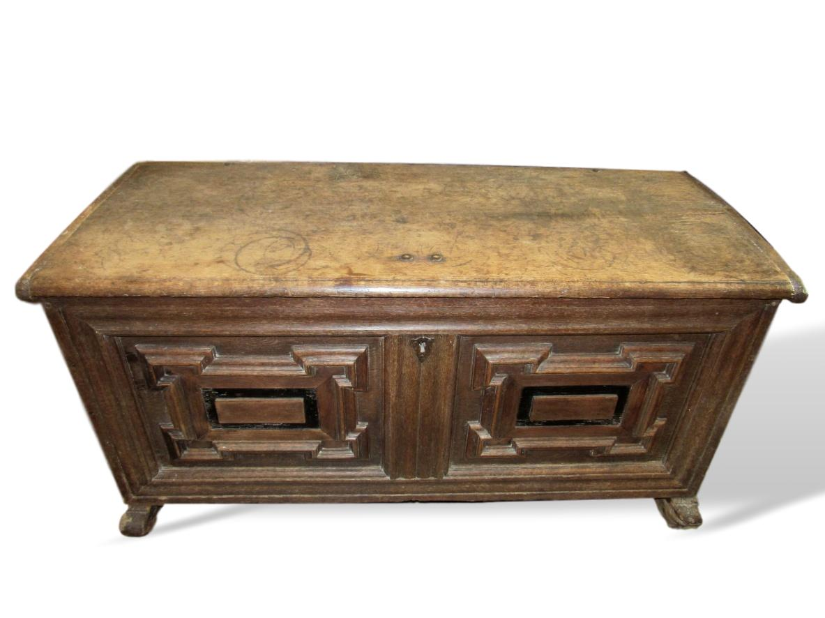 Lot 82 -A 17th century oak chest with iron carry handles, geometric applied moulding & original lock