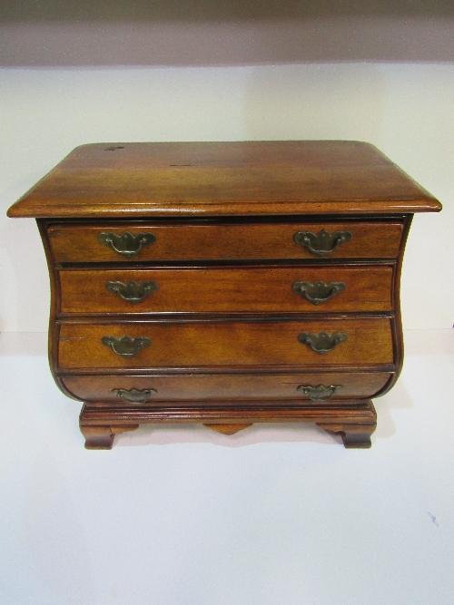Lot 142 - Miniature 'bombe' style mahogany chest of 4 drawers