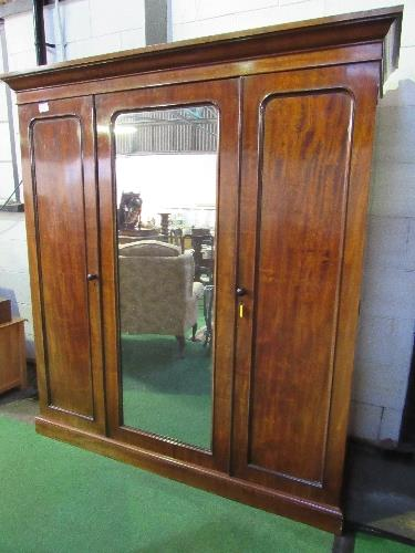 Lot 21 - A Heal & Son mahogany wardrobe with interior drawers & open drawers c/w mirror door