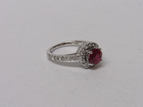 Lot 562 - 18ct white gold, ruby & diamond ring, wt 5.5gms, size K½