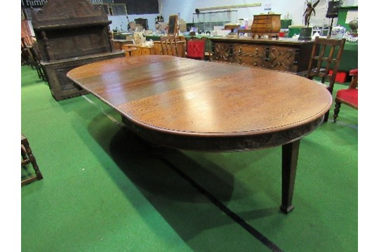 Lot 87 - Large oak extending dining table, believed to be by Waring & Gillow, c/w 6 leaves