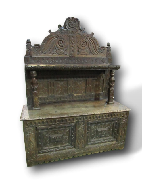 Lot 91 - Large carved oak dresser with panelled back & shelf supported by 2 carved figures
