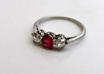 Lot 443 - Platinum, diamond & ruby ring, size J 1/2